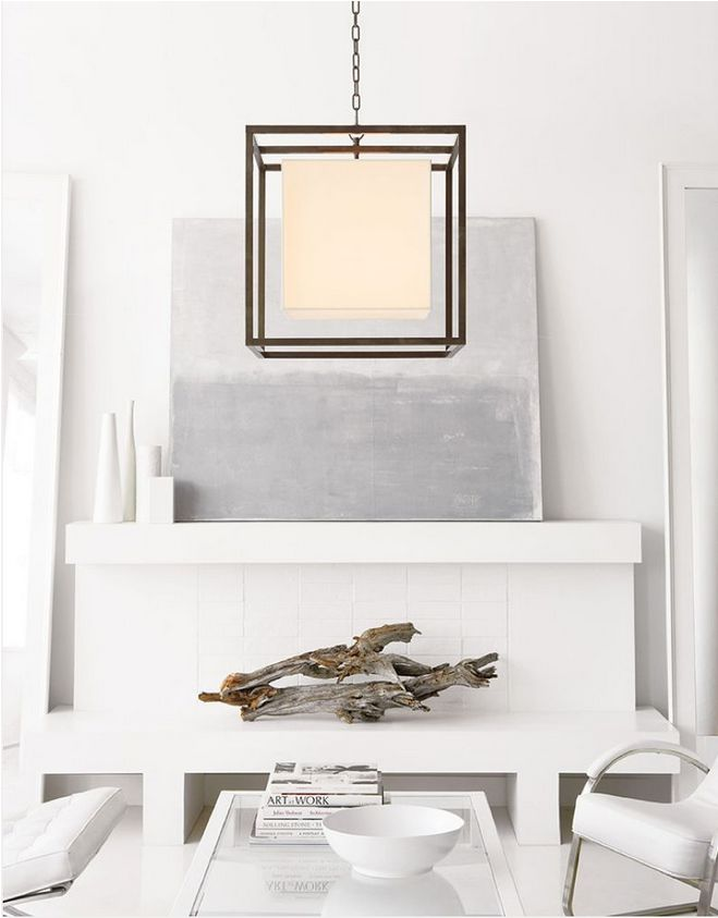 This #modern space features a statement light fixture from Coral Gables, FL-based Pego Lamps.