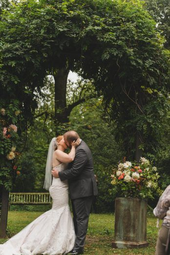 bride and groom first kiss at the alter, first kiss wedding portraits  | hendry house, stephanie dee photography