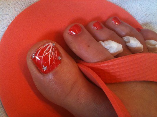 4th of July Glitz. Fireworks nail art design over Sation Red Hot Orange. Nail Art Pedicure by Mai