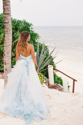 From our wedding experts at Style Me Pretty, real brides who skipped the traditional all-white gown route for a fashion-foward bridal look: In R-Mine Bridal Couture.