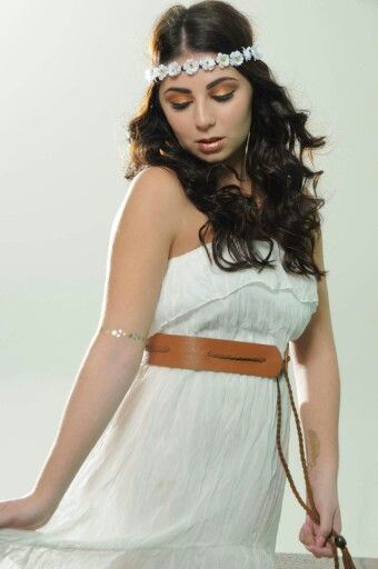 Bohemian model and copper makeup with flower crown and flash tattoos and white dress good for coachella.