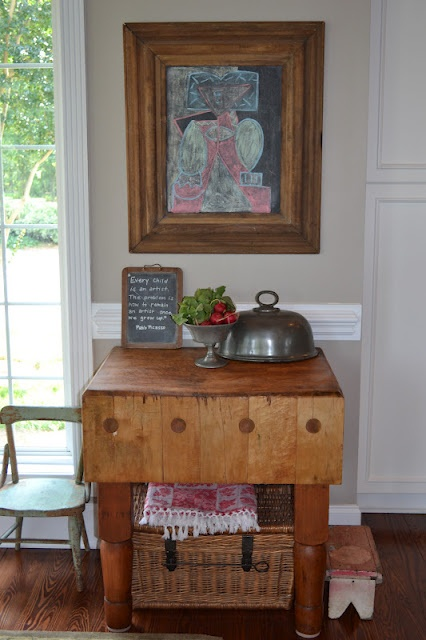 A restored antique butcher's block via Three Pixie Lane