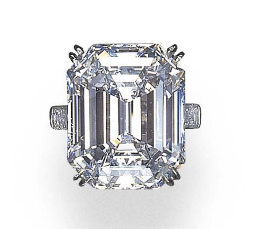 Oh Mama! A MAGNIFICENT SINGLE-STONE DIAMOND RING   Set with a rectangular-cut diamond weighing approximately 32.73 carats, flanked by baguette-cut diamonds, mounted in platinum