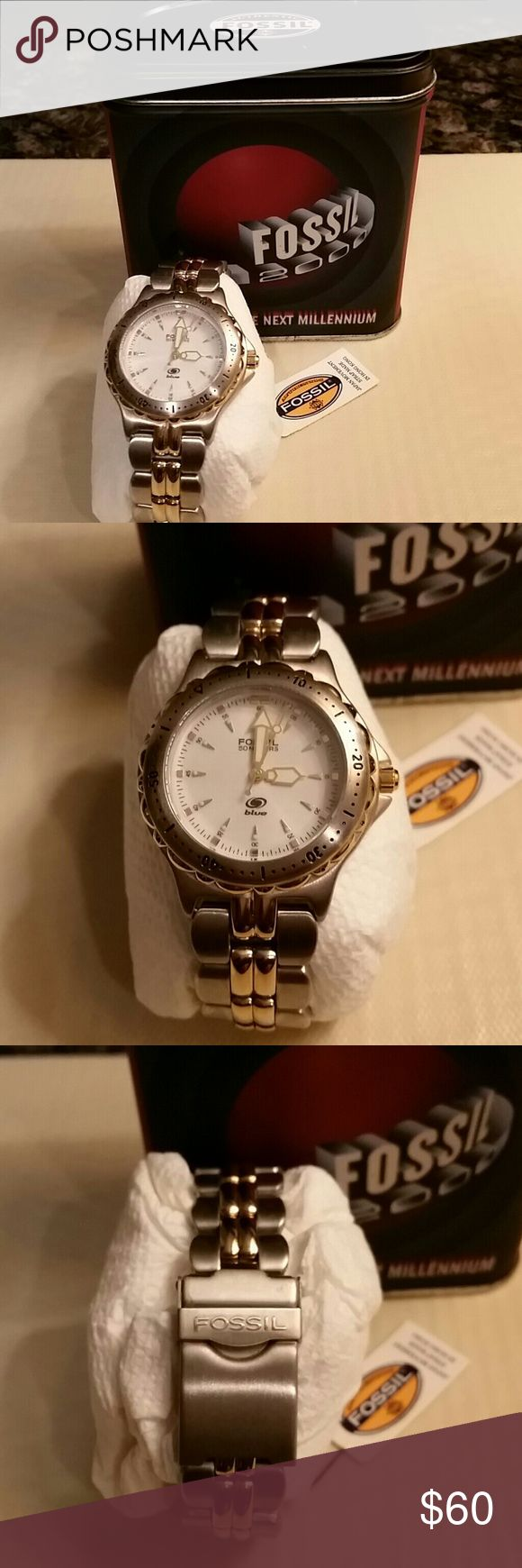 Fossil Mens Watch - Fossil Blue Mens Fossil Stainless Steel and Gold Tone Watch.  With adjustable links.  Hands illuminate in the dark.  Water Resistant.  Brand New!  Never worn!  Excellent Condition!  Comes in the original Tin Case.  Reasonable Offers Wiil Be Considered👌 😄👍! Fossil Accessories Watches