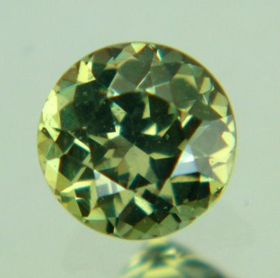 Gemstone: Unheated Sapphire - Carat: 0.71 -  Comment: Ring-size, mildly colored green sapphire with 5mm+. Precision cut and as good as 'free of inclusions'. Smooth earthly character, sparkly but not flashy.  http://wildfishgems.com/inc/sdetail/15707
