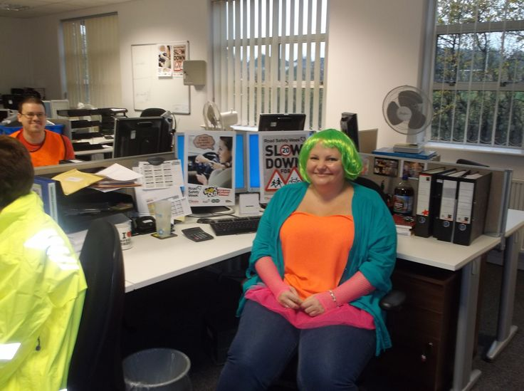 Spencers accounts team dressing bright clothes and wig taking part in Bright Day
