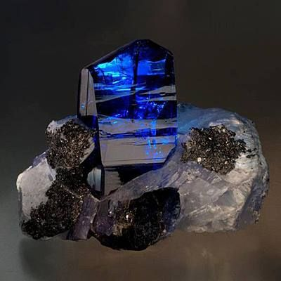 Wow.. Tanzanite, one of December's birthstones, is relatively new to the colored stone galaxy. As the most common story of the tanzanite mining boom goes, in 1967 a Masai tribesman stumbled upon a cluster of highly transparent, intense blue crystals weathering out of the earth in Merelani, an area of northern Tanzania. He alerted a local fortune hunter named Manuel d'Souza, who quickly registered four mining claims.