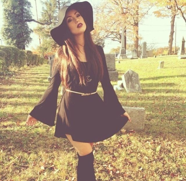 Dark fall / winter bohemian fashion. longsleeve black dress with knee high socks and black floppy wide brimmed hat outfit idea