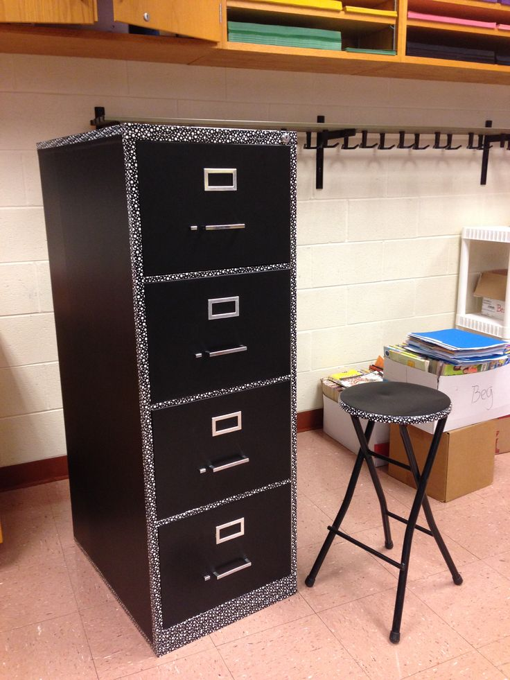 Chalkboard adhesive and polka dot tape turns an old file cabinet and stool into this.