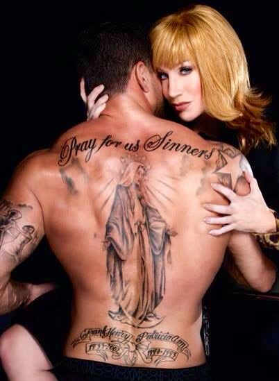 Kathy Griffin and hot tattooed man