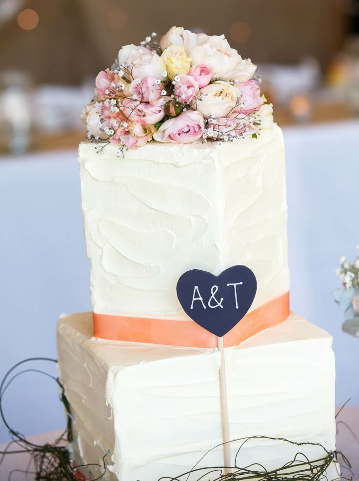 Diamond set natural stucco look buttercream in square with dodda vine, fresh flowers and hand created blackboard.