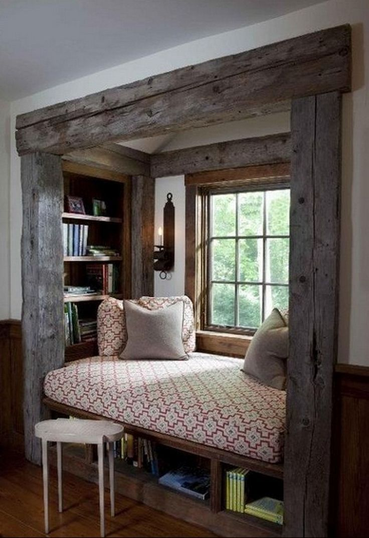 Not a bed, but this is wonderful.  I love the smaller window (from the standpoint of how it would feel sitting in there.  Perhaps that would throw off balance of entering and seeing windows and whole room.)  Book case inside???  Very cool.