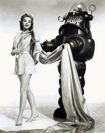 Anne Francis as Altaira in Forbidden Planet with Robby the robot.