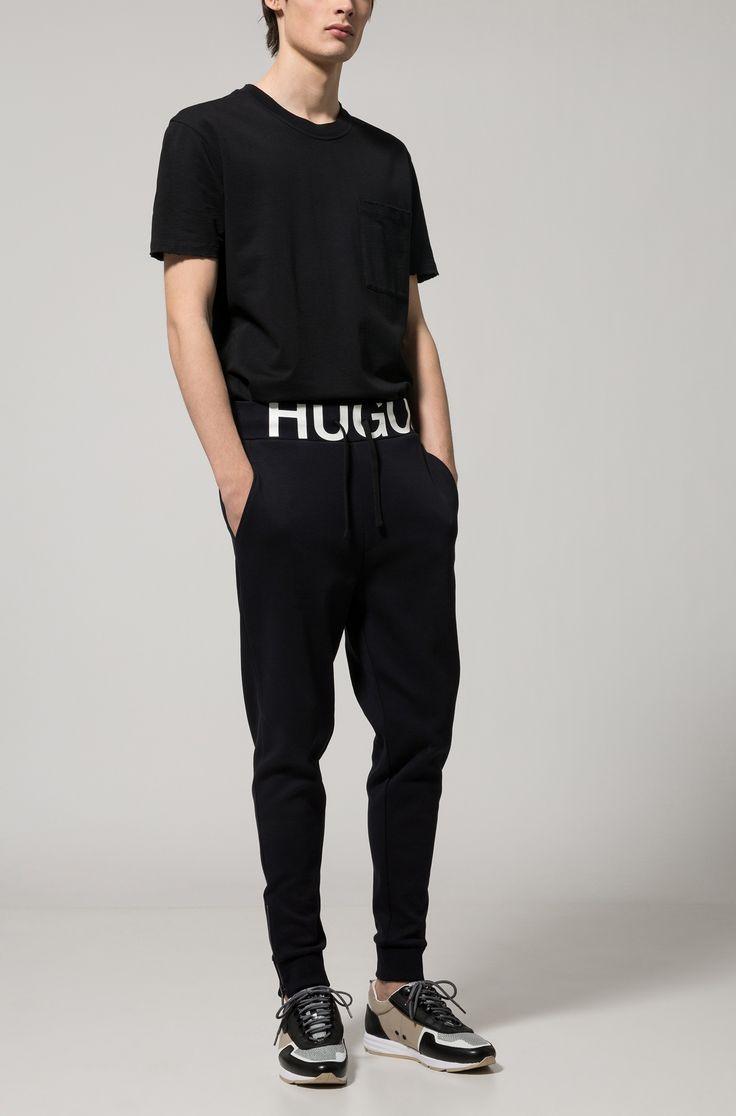 Pantalones regular fit de punto de algodón con logo en la cintura Negro desde HUGO para Hombre para 119,00 € en la tienda online oficial de HUGO BOSS free shipping