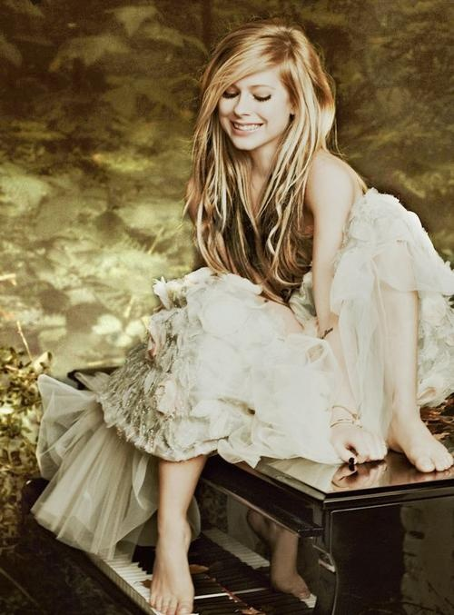Avril Lavigne. Love the new stuff on her new Goodbye Lullaby album! It's like her older acoustic tunes!