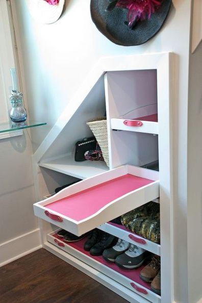 An otherwise unusable dormer space is converted and now serves as a fabulous storage space in a closet