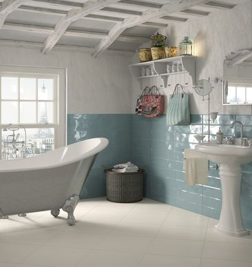 A fresh, summery bathroom with light blue and white tiles.
