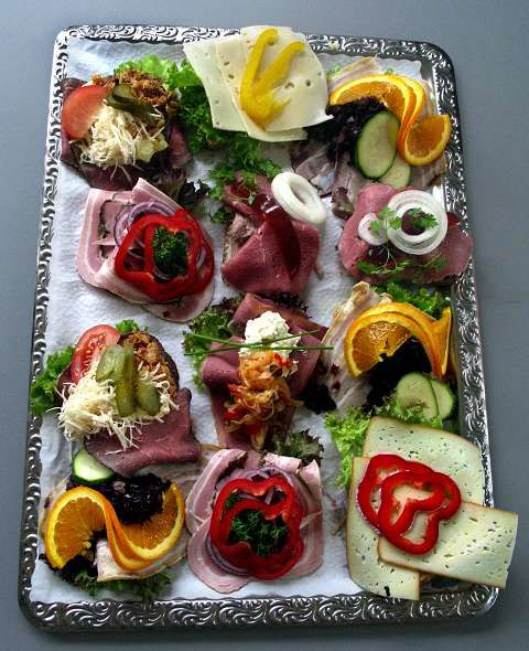 "Smørrebrød is the most classic and popular dish in Denmark.  The word literally translates to ""butter and bread"" in English."