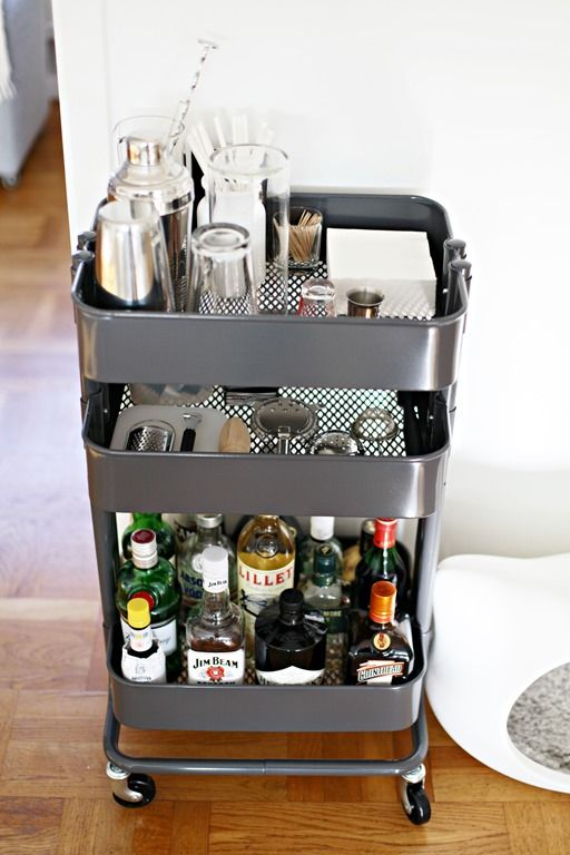 The bottles go on the bottom shelf, the glasses on the top and everything else in the middle.