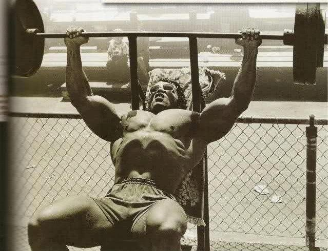 Arnold Schwarzenegger doing incline benches on the outside patio Gold's Gym Venice Beach