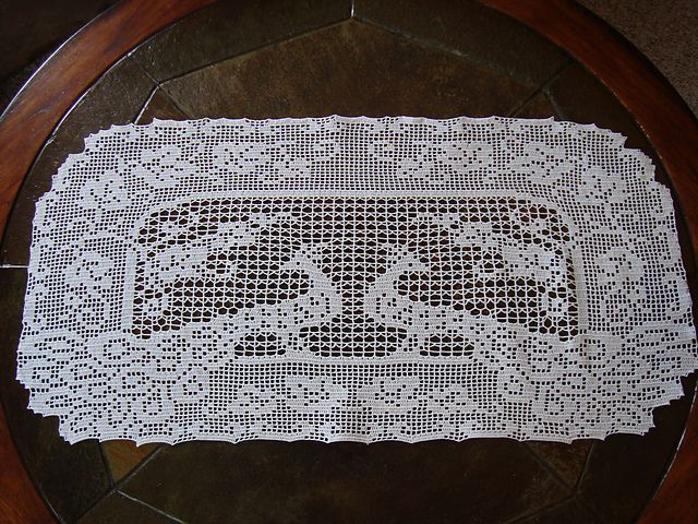 Ravelry: Filet Crochet Peacock Buffet Scarf.  Free pattern by Lily Mills Company.