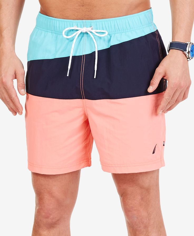 A colorblocked design lends bold style to the functional quick dry fabric of these swim trunks from Nautica. | Nylon; lining: polyester | Machine washable | Imported | Elastic waistband | Drawstring |