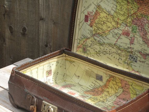 vintage suitcase lined with world map, the perfect thiing to pair up with travel stickers and postcards