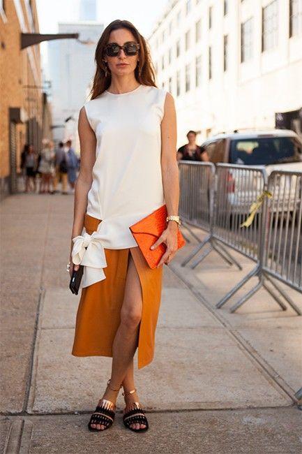 What she's wearing: Céline top, skirt and sunglasses, Azzedine Alaïa sandals, vintage bag