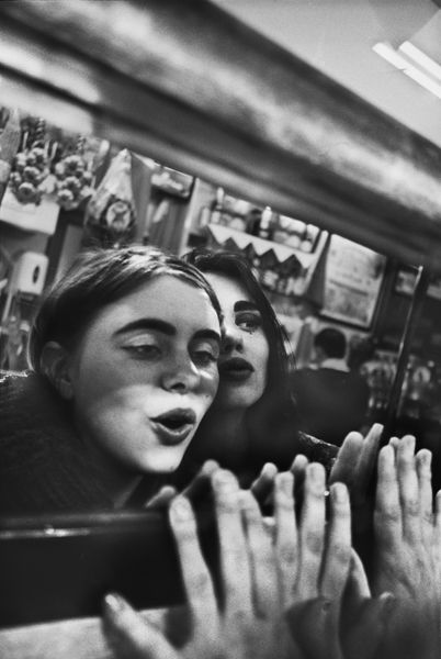 Anders Petersen - Soho I like the use of the reflection here. You feel like you are stood there with there two girls because of how close up this image is.