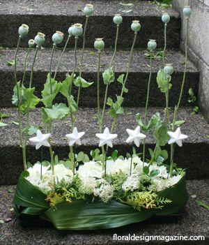 White Christmas European styled #floral  #arrangement www.floraldesignmagazine.com/Christmas annuals.html #Christmas #holidayflowers #Xmas