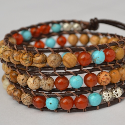 HB Earth triple wrap bracelet has been designed combining Picture Jasper, Carnelian and Turquoise Gemstones, a truly perfect and powerful combination. This is a very organic and trendy piece, created to help you feel the connection to Earth and your true self, allowing it to flow through you and balance you completely. On brown chocolate genuine leather, finished with a unique italian silver button clasp and silver accent beads.