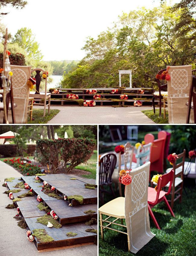 For an Anthropologie-esque setup, try stacking pallets on top of each other to create a mini wooden stage, then slip in flower arrangements to brighten the look.