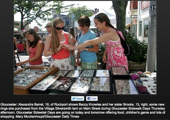 Customer's flocking to the streets during the sidewalk bazaar in Gloucester, Village Silversmith's booth.  Gloucester Daily Times  www.villagesilversmith.net