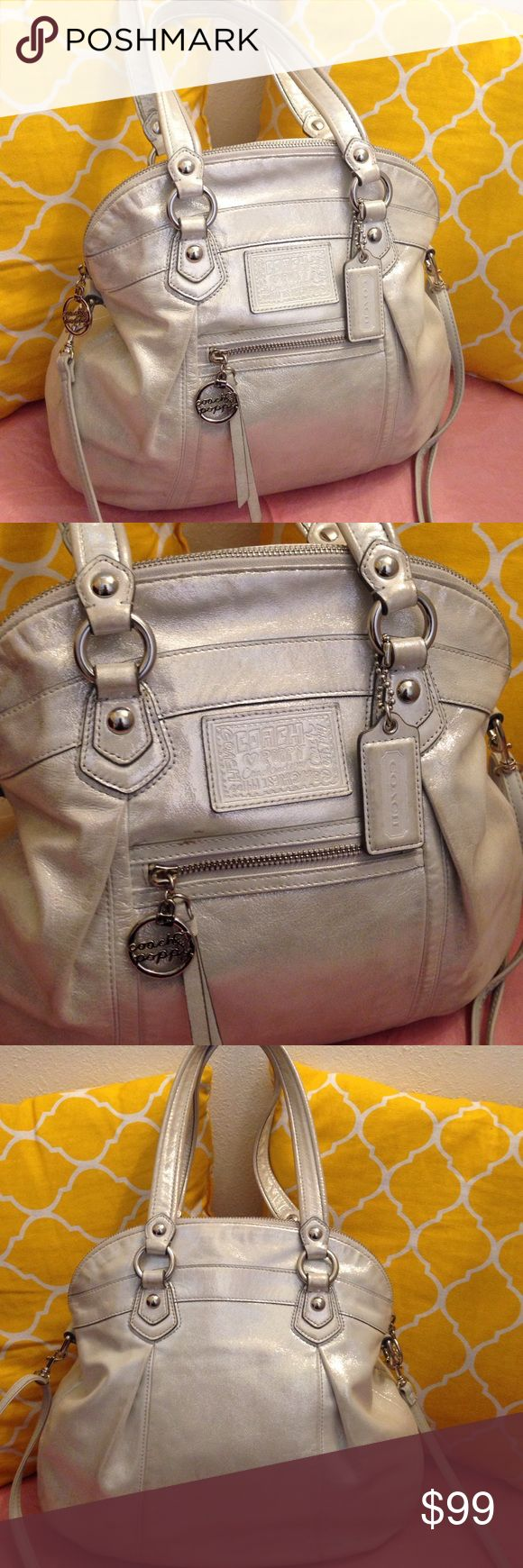Coach Poppy Glam Metallic Silver Opal Shiny and shimmery. Has detachable long strap and coach hangtag. Medium size holds a lot. With pockets inside and outside too. Silver metallic. Has two spots on front i believe can be wipe off. Coach poppy collection. Authentic Coach Poppy. Coach Bags Satchels