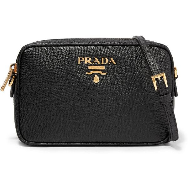 Prada Camera textured-leather shoulder bag (12.555.890 IDR) ❤ liked on Polyvore featuring bags, handbags, shoulder bags, black, zip purse, shoulder bag purse, camera shoulder bag, shoulder handbags and zipper purse