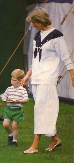 June 14, 1987 Princess Diana and Prince Harry with his plate of strawberries at a polo match at Smith's Lawn in Windsor Diana, Princess of Wales 1961-1997