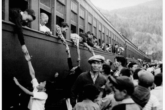 This picture is showing Japanese Canadians being sent to Internment camps in B.C. This is a credible source because it was taken at the scene and was published by a photographer at the time. It shows Canadian lives changing because they are being take from their homes and sent into interment camps because the government does not trust them and they have to leave almost everything they have behind.