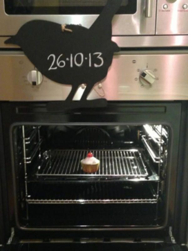 Bun cooking in an oven with a sign above it showing the baby's due date