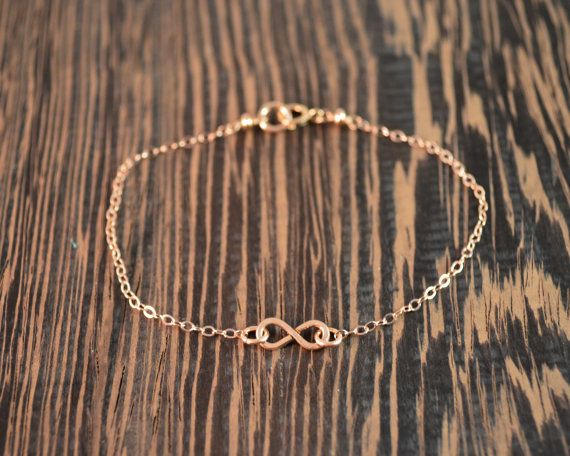 -sets or individual bracelets   -14k Rose Gold Fill   -7 inches long    Infinity symbols are very trendy right now.  This bracelet is not only fashionable but also good as a reminder of karma, infinite potential, and symbols of love or friendship.  They are a great gift for friends graduating, bridesmaids, or just for your bff.  Or you can just get one for yourself.      At the center of each bracelet is a hand formed infinity symbol made of 14k rose gold fill. The rest of the bracelet is…