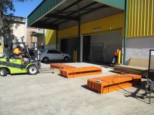 storage racks being moved into a self storage unit of a small business