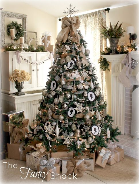Christmas tree using burlap for garland.  Burlap also used on the packages