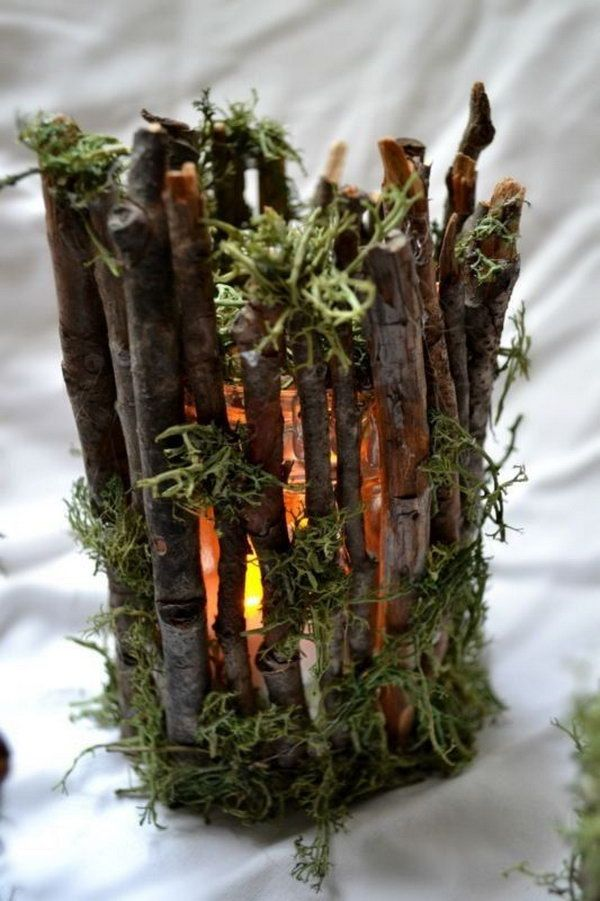 These rustic twig candle holders are perfect for wedding decoration. http://hative.com/diy-ideas-with-twigs-or-tree-branches/