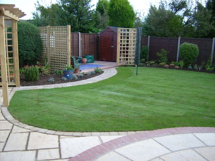 Patio with summerhouse google search landscape for Back garden designs uk