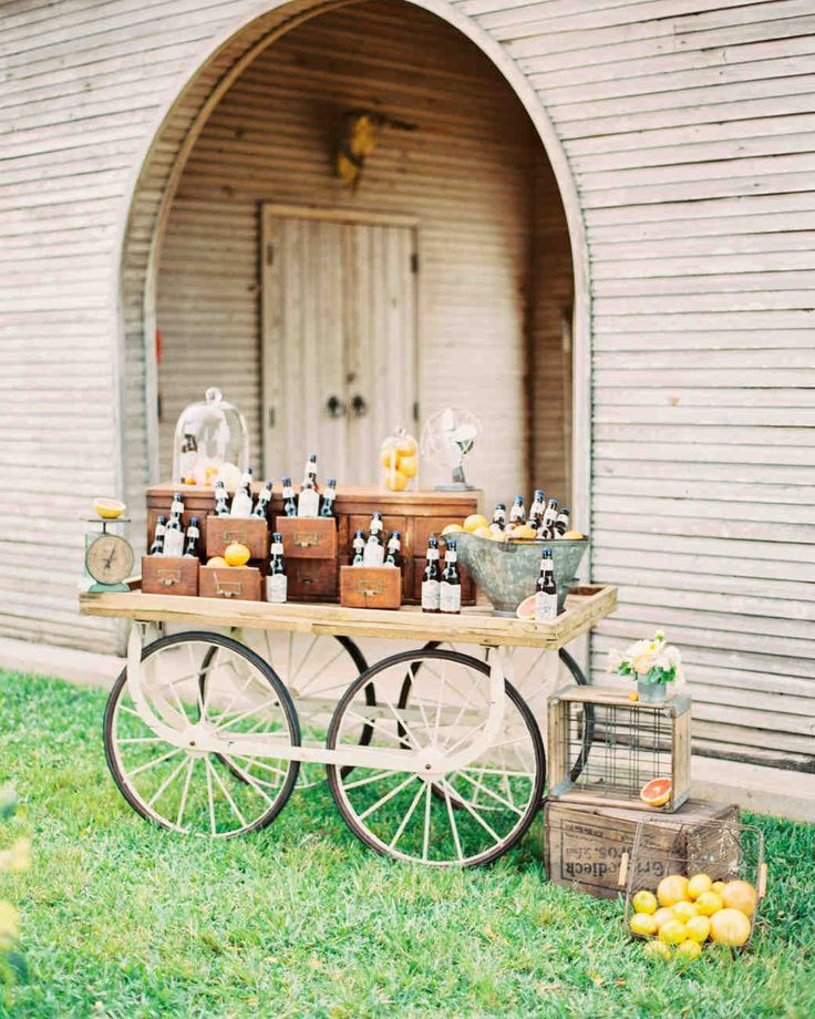Trending Now: Drink Stations to Elevate Your Reception | Martha Stewart Weddings - If you and your groom are big craft beer drinkers, consider displaying and serving them in a special way during cocktail hour or the reception. Here, an antique wagon housed chilled beer bottles for guests to grab as they pleased.