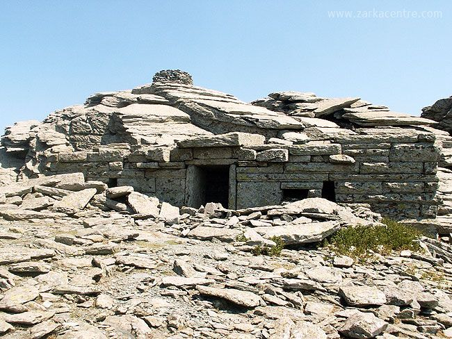 The dragon house (drakospito) is under Ochi's highest peak. In southern Karystos. The one that is near the summit of Ochi is the most significant. This ancient rectangular structure measuring 4.85 metres by 9.80 is made of huge stones with no mortar. The entrance is on the long side, in contrast to ancient temples whose entrance was on one of the shorter sides. The walls are so thick one naturally imagines supermen placing the stones in rows with enviable skill. Design Stories