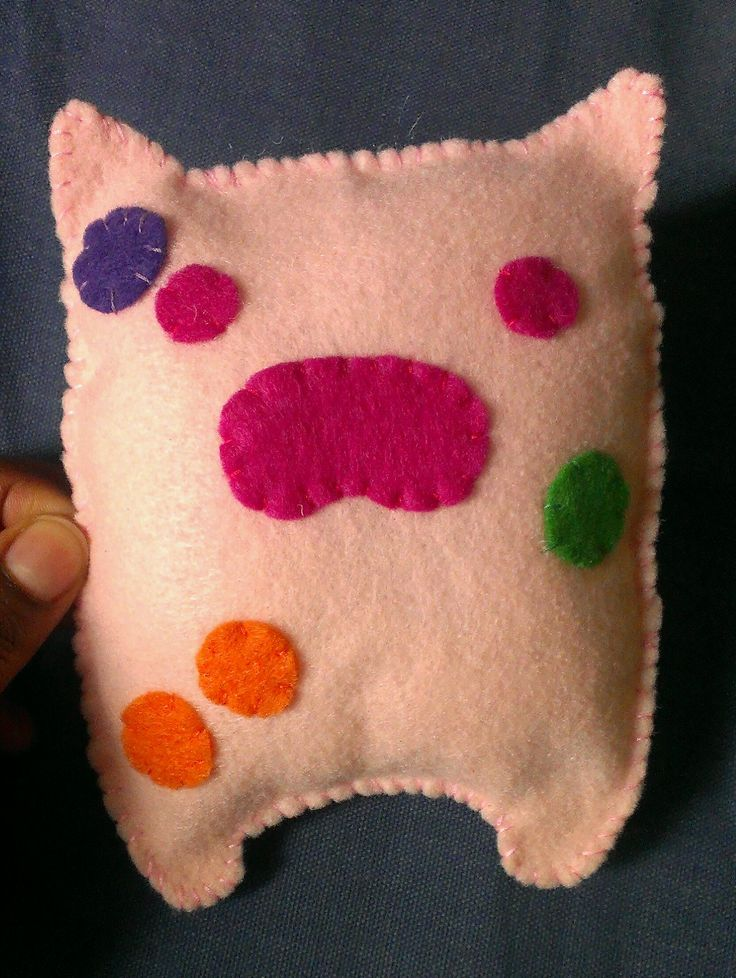"""A version of the pig DIY video from the DIY board. I changed the color and didn't add as much stuffing as last time. I thought it turned out ok...still think something can be added to make it feel more """"pig""""."""