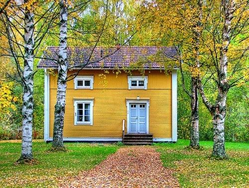 yellow house in Västerbotten, Sweden; photo by Flickr user ~Frida*~