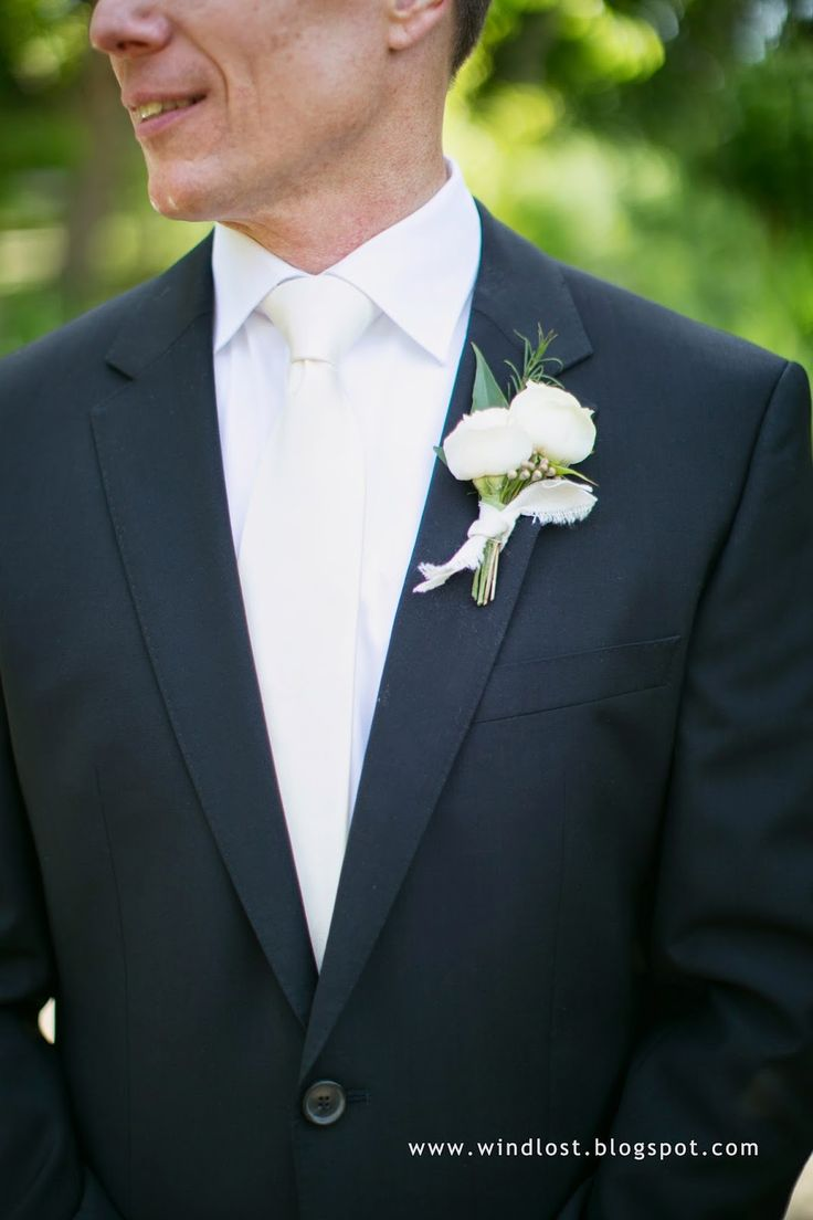 ~ Wind Lost ~  Our lovely, romantic and elegant June wedding.  Our color scheme was white/ivory, black, soft pink and gold/champagne. Boutonniere of ivory spray roses and miniature wax flower, tied with muslin.