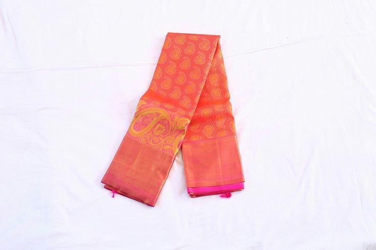 Peach colour wedding saree in 3 gram gold zari all over the saree in butta design from the makers of Kanchipuram sarees Shop for our wedding sarees at : http://kanjivaramsilks.com/wedding-sarees-online #weddingsarees #silksarees