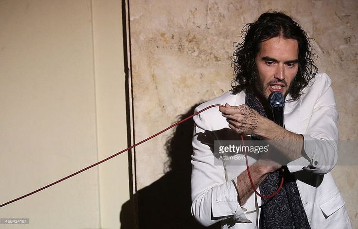 British Comedian Russell Brand steps out into the audience while performing his stand-up comedy show 'Messiah Complex' at Admiralspalast on February 10, 2014 in Berlin, Germany.